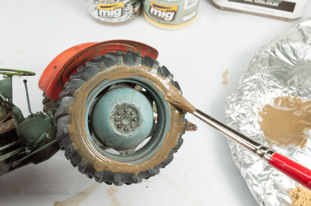 Applicating the mud mixture, Ferguson by Heller